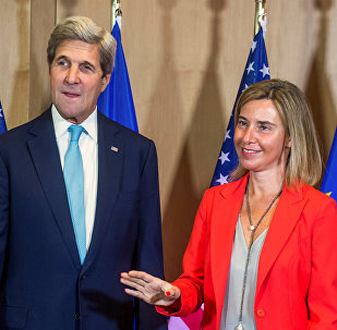 U.S. Secretary of State John Kerry poses with EU foreign policy chief Federica Mogherini (R) during an European Union foreign ministers meeting in Brussels, Belgium, July 18, 2016.