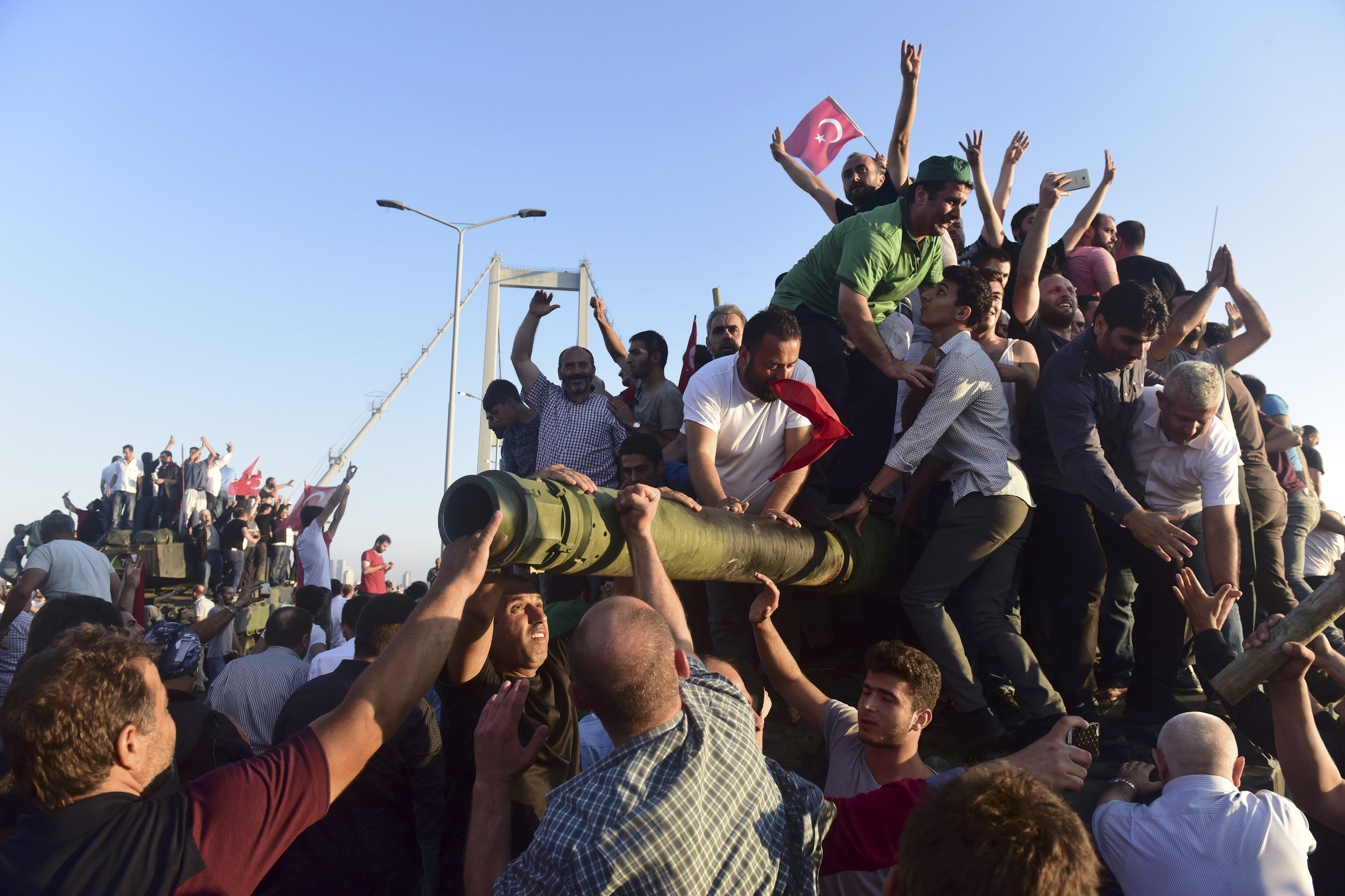 Supporters of Tukish President Tayyip Erdogan celebrate after soldiers involved in the coup surrendered on the Bosphorus Bridge in Istanbul, Turkey July 16, 2016