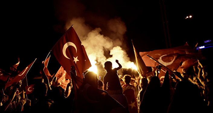Pro-Erdogan supporters wave Turkish national flags during a rally at Taksim square in Istanbul on July 18, 2016 following the military failed coup attempt of July 15