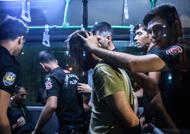 A file photo showing Turkish anti riot police officers detain a Turkish soldier who allegedly took part in a military coup as they are leaving in a bus the courthouse at Bakirkoy district in Istanbul on July 16, 2016