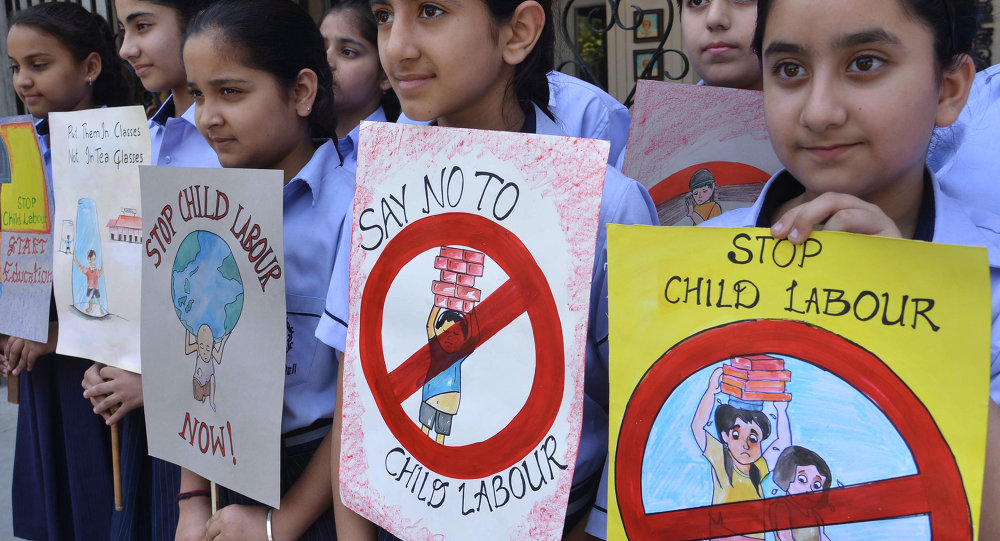 Indian students hold placards during a demonstration against 'child labour'