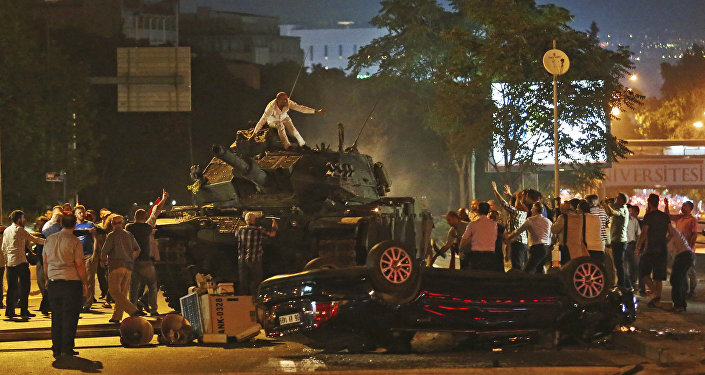 In this July 16, 2016, file photo, tanks move into position as Turkish people attempt to stop them in Ankara, Turkey
