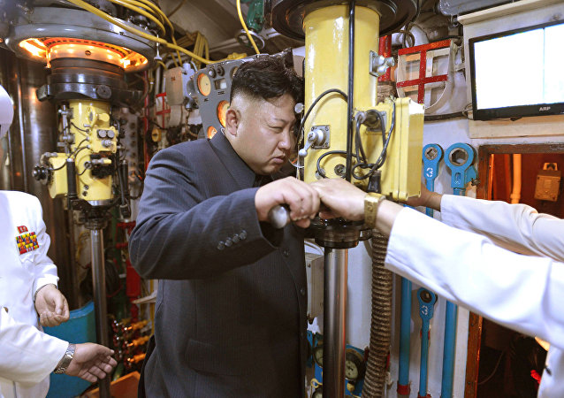 North Korean leader Kim Jong Un (C) looks through a periscope of a submarine during his inspection of the Korean People's Army (KPA) Naval Unit 167 (File)