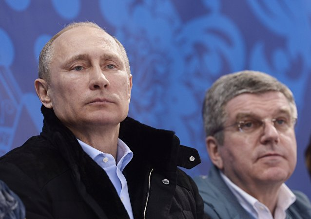 Russian President Vladimir Putin, left, and President of the International Olympic Committee Thomas Bach (File)