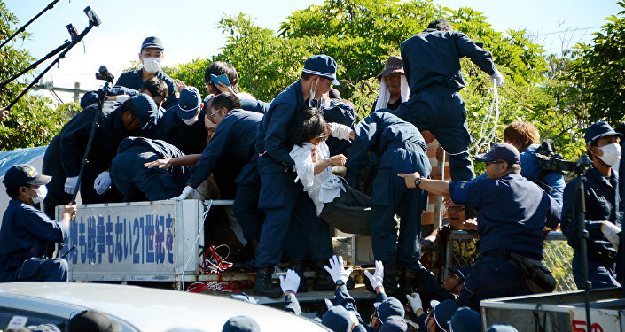 People protesting against restarting the construction of helipads for US forces clash with riot police in Higashi-son, Okinawa prefecture on July 22, 2016