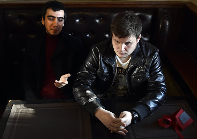 Russian pranksters (L-R) Vladimir Vovan Kuznetsov, 30, and Alexei Lexus Stolyarov, 28, speak during an interview with AFP at a bar in Moscow, on March 14, 2016