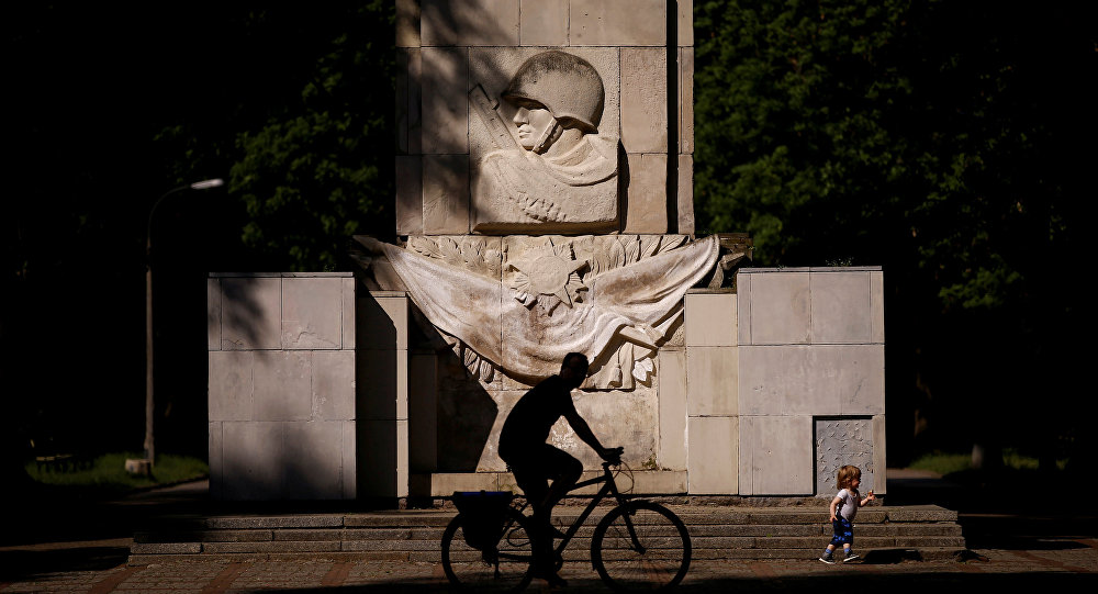 A man rides a bike in front of the monument of the Gratitude for the Soviet Army Soldiers in Warsaw, Poland May 23, 2016