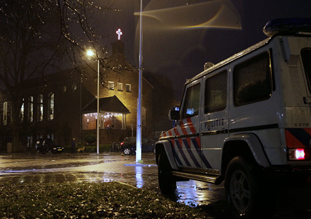 A police vehicle guards the Coptic church, rear, in Amsterdam, Netherlands (File)