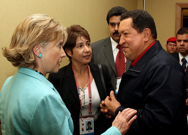 Venezuelan President Hugo Chavez listens to US Secretary of State Hilary Clinton during the Summit of the Americas in 2009