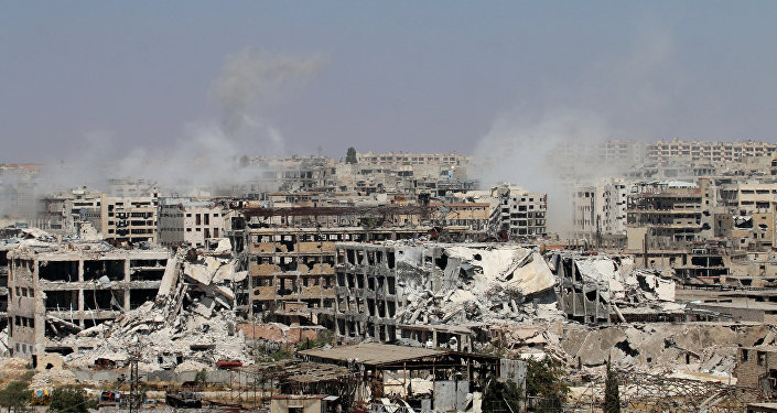 Smoke billows from buildings during an operation by Syrian government forces to retake control of the rebel-held district of Leramun, on the northwest outskirts of Aleppo, on July 26, 2016