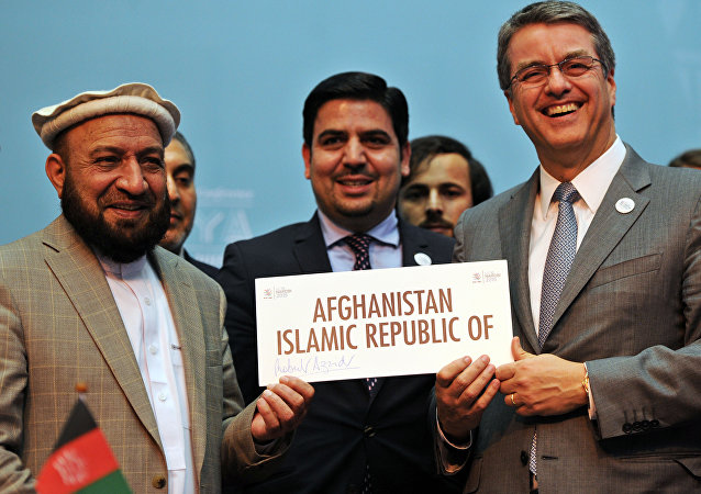 First deputy Chief Executive of the Islamic State of Afghanistan, Mohammad Khan (L) poses with World Trade Organisation (WTO) Director-General - Roberto Azevedo during a ceremony marking the accession of Afghanistan to the WTO, on December 17, 2015 in Nairobi