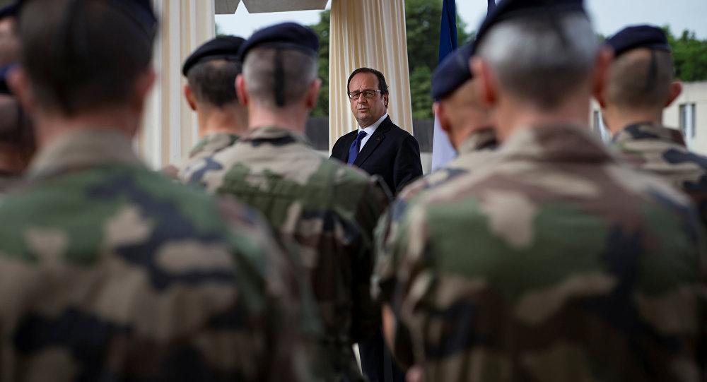 French President Francois Hollande reviews troops at the Army base and command centre for France's 'Vigipirate' plan, dubbed 'Operation Sentinelle', at the fort of Vincennes, on the outskirts of Paris, France, July 25, 2016