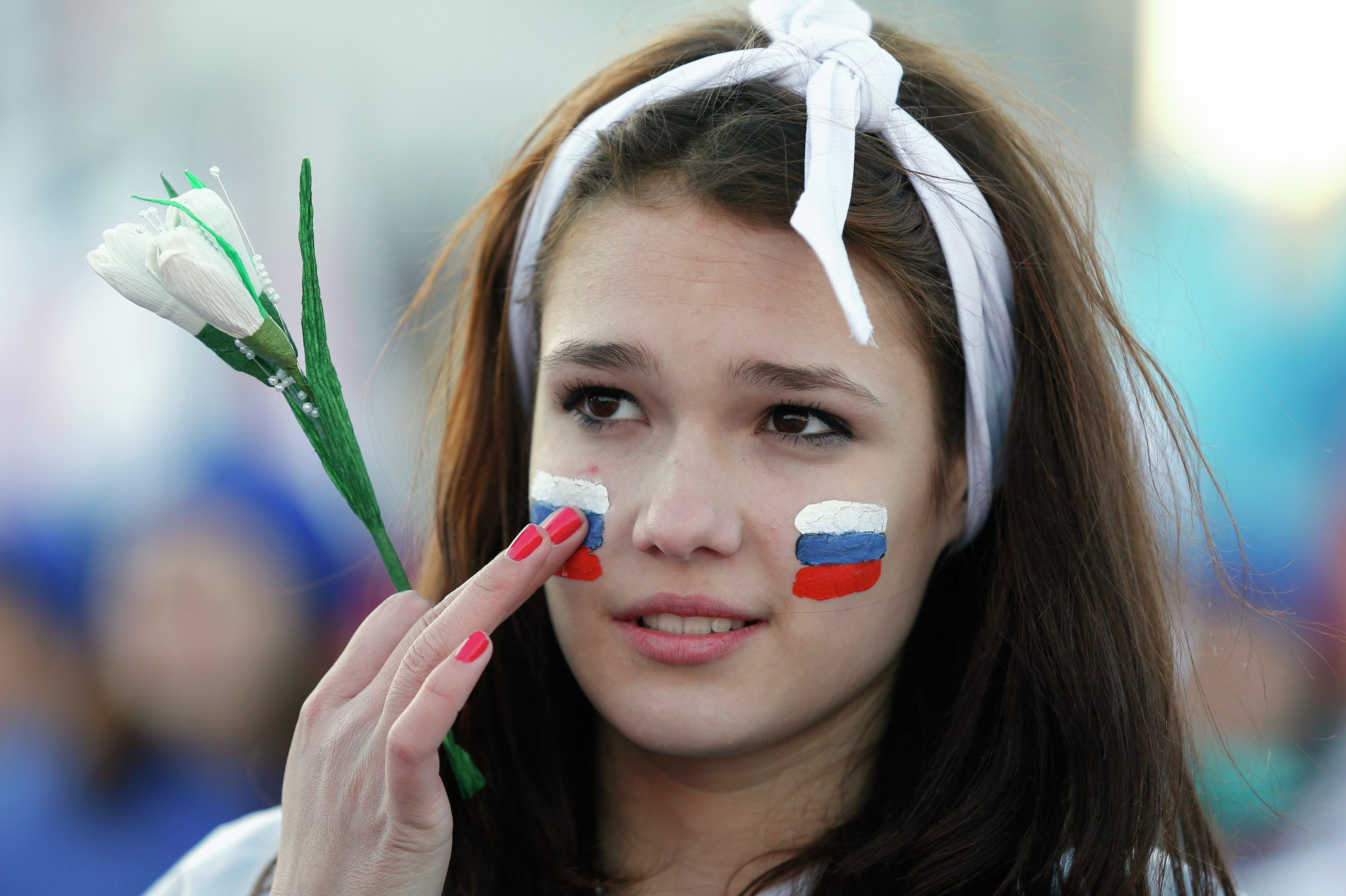 A girl with Russian national flags painted on her cheeks takes part in celebrations marking the one-year anniversary of Crimea voting to leave Ukraine, in central Simferopol March 16, 2015.