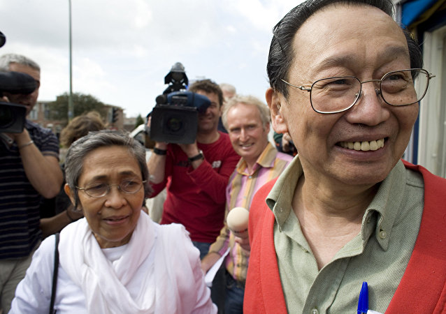 Philippine communist leader Jose Maria Sison, right, smiles after being released from Scheveningen prison outside The Hague, the Netherlands, Thursday, Sept. 13, 2007.