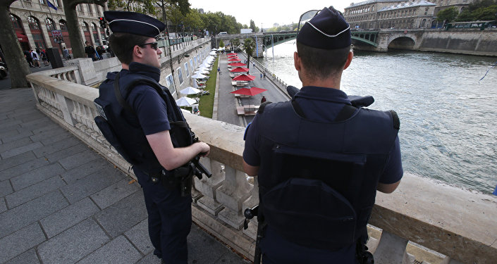 French police officers patrol over the Seine river at Paris Plage (Paris Beach) Friday, Aug. 5, 2016 in Paris