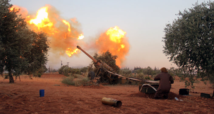 Opposition fighters fire shells from their position in Aleppo's southern countryside (File)