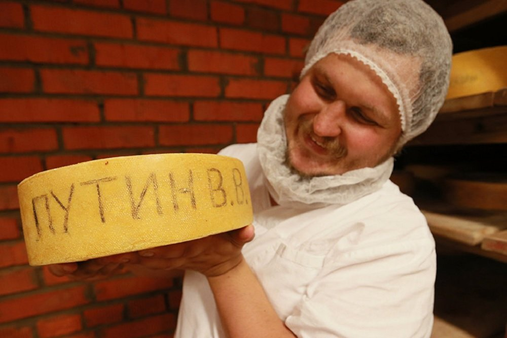 Farmer Oleg Sirota shows wine cheese in the cheese ripening room at Russian Parmesan cheese dairy is Moscow Region's Istrinsky district