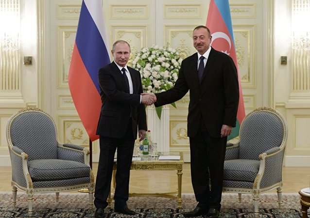 Russian President Vladimir Putin, left, and President of Azerbaijan Ilham Aliyev during a meeting at Genclik residence in Baku