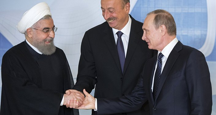 August 8, 2016. From right: Russian President Vladimir Putin, President of Azerbaijan Ilham Aliyev and Hassan Rouhani, President of the Islamic Republic of Iran, during a photo session prior to the beginning of the trilateral meeting in Heydar Aliyev Center, Baku.