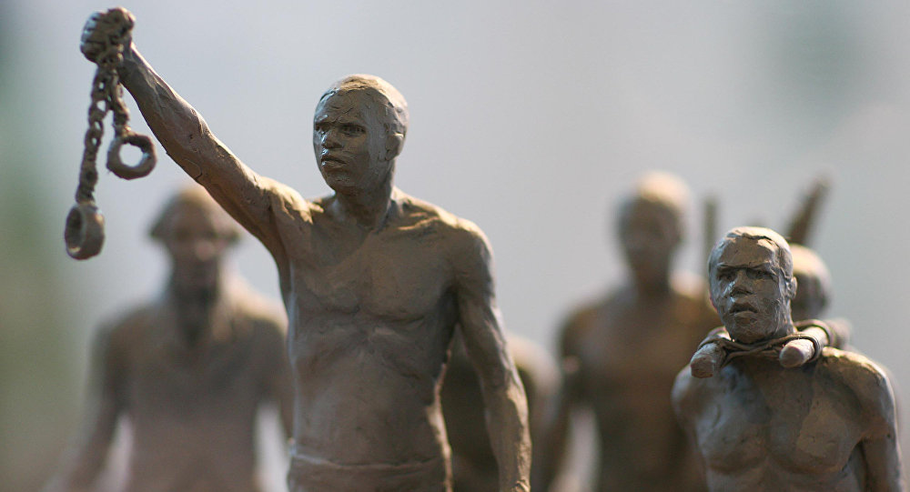 A maquette of a statue commemorating the enslaved Africans whose lives were lost during the slave trade is pictured as it is unveiled by London Mayor Boris Johnson in central London, on August 18, 2008. The statue is to be erected in Hyde Park