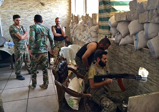 Syrian army troops during the assault on the artillery school in the south-east of Aleppo, Syria