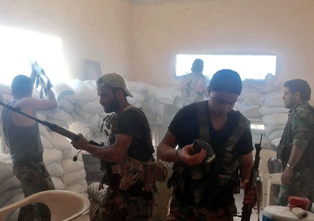 Syrian army fighters during a fight in south-western Aleppo, Syria