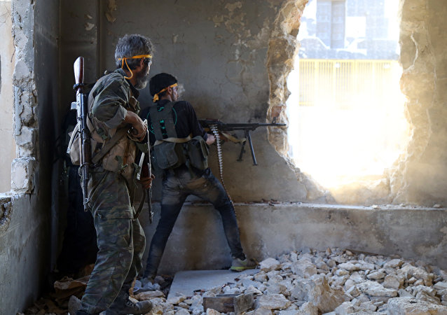 Rebel fighters fire towards positions of regime forces in Ramussa on the southwestern edges of Syria's northern city of Aleppo on August 6, 2016