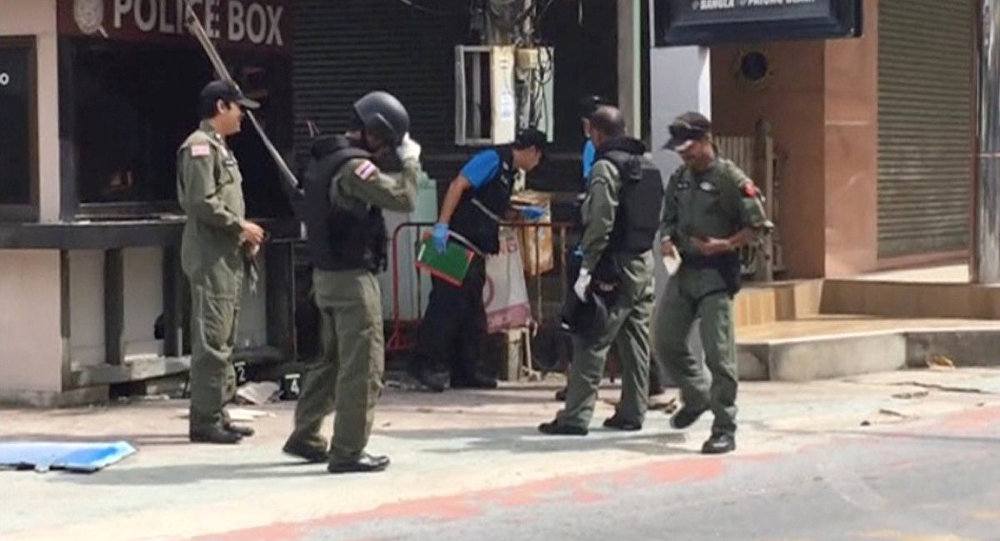 Officials investigate at the scene of bomb blasts in the tourist beach town of Patong on Phuket island, Thailand in this still image from video August 12, 2016
