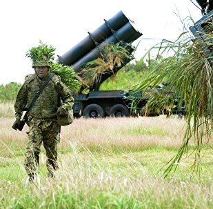 A soldier from Japan's Ground Self-Defense Force helps to prepare surface-to-ship missile launchers at Camp Naha in Naha, Okinawa Prefecture (File)