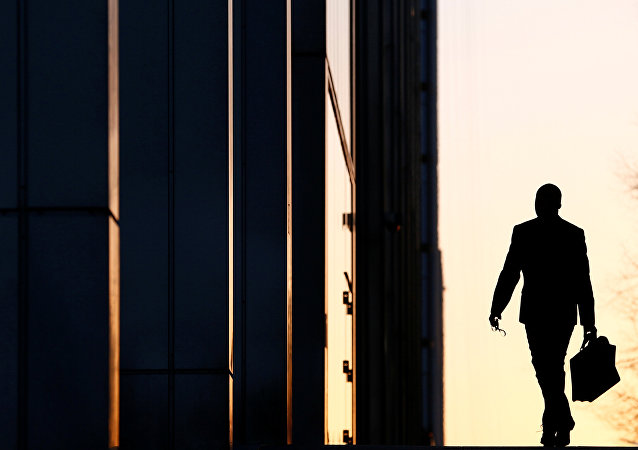 A worker arrives at his office in the Canary Wharf business district in London (File)