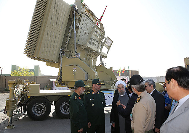 Iran's President Hassan Rouhani (3rd L) and Iranian Defence Minister Hossein Dehghan (2nd L) stand in front of the new air defense missile system Bavar-373, in Tehran, Iran August 21, 2016