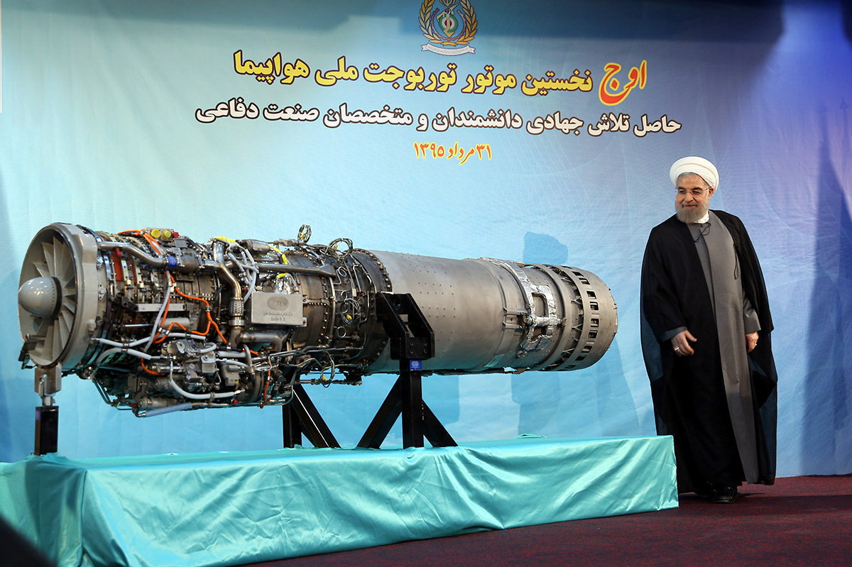 Iran's President Hassan Rouhani stands next to an Iranian-made fighter jet engine, in Tehran, Iran August 21, 2016