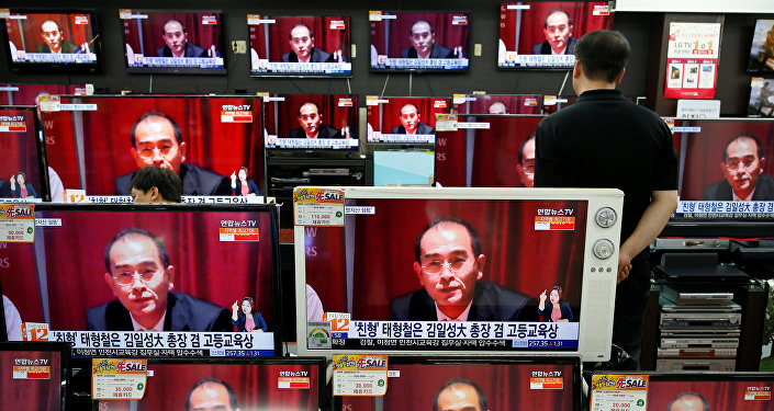 A sales assistant watches TV sets broadcasting a news report on Thae Yong Ho, North Korea's deputy ambassador in London, who has defected with his family to South Korea, in Seoul, South Korea, August 18, 2016