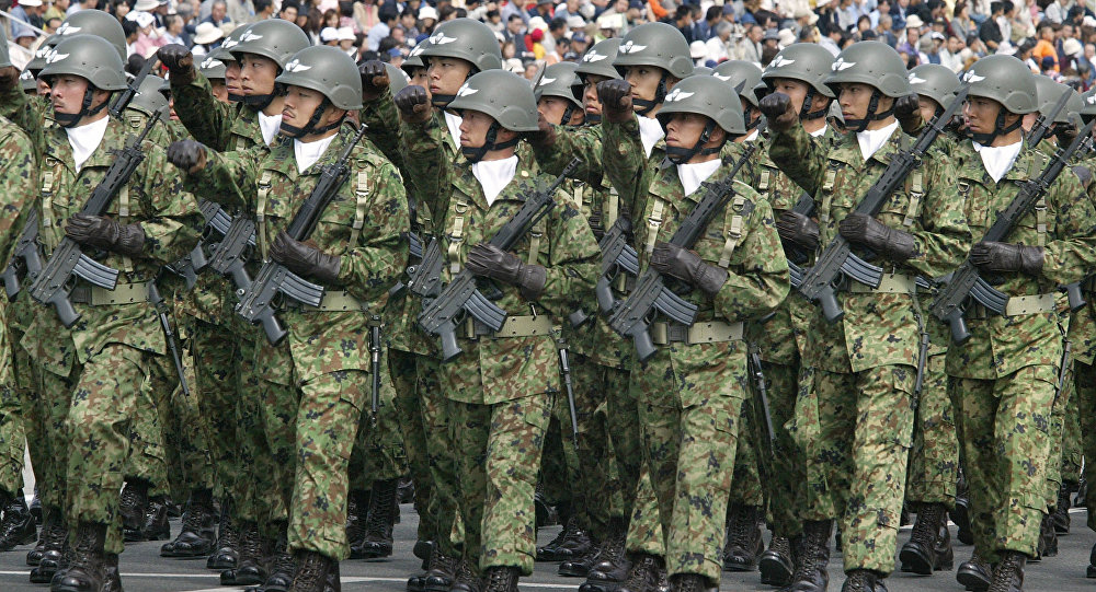 Troops of Japan Grand Self-Defense Force (JGSDF) 1st Airborne Brigade march during an inspection parade for the JGSDF Eastern Army 44th anniversary celebration at Asaka training field, suburban Tokyo.