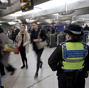 A British Transport Police Community Support officer stands by the barriers at Westminster underground train station in London, Monday, Dec. 7, 2015