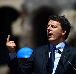 This file photo taken on July 1, 2016 shows Italian Prime Minister Matteo Renzi speaking during a press conference in Rome to announce the end of the restoration of the façade of the Colosseum financed by top luxury brands