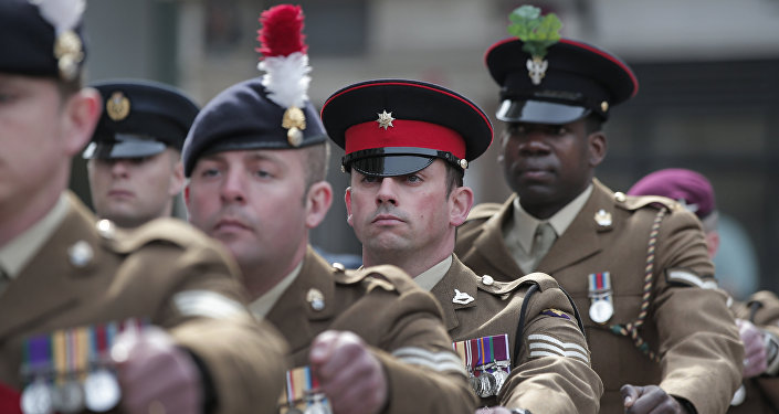 Members of Britain's armed forces parade to their positions outside St Paul's Cathedral, in central London, for the Service of Commemoration – Afghanistan, Friday, March 13, 2015