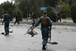Afghan security personnel work at the site of an explosion in Kabul, Afghanistan, Thursday, Aug. 18, 2016