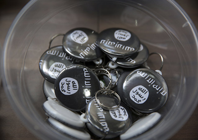 Daesh group pins.