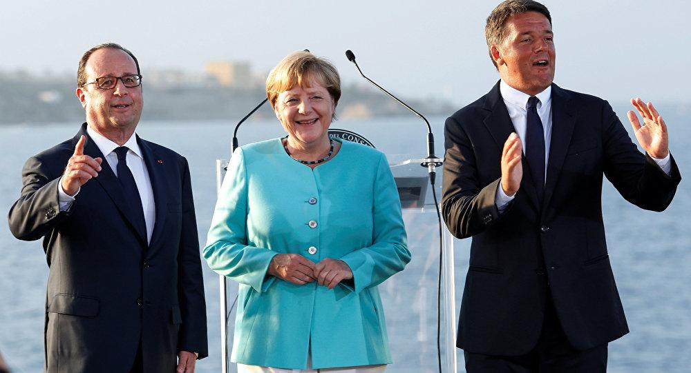 Italian Prime Minister Matteo Renzi, German Chancellor Angela Merkel (C) and French President Francois Hollande (L) pose on the Italian aircraft carrier Garibaldi off the coast of Ventotene island, central Italy, August 22, 2016.
