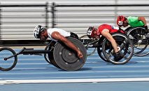 Casey Followay, left, Stephen Binning, center, and Arturo Torres, right, race in their heat in the men's 100-meter dash during the U.S. Paralympics Team Trials in Charlotte, N.C., Friday, July 1, 2016.