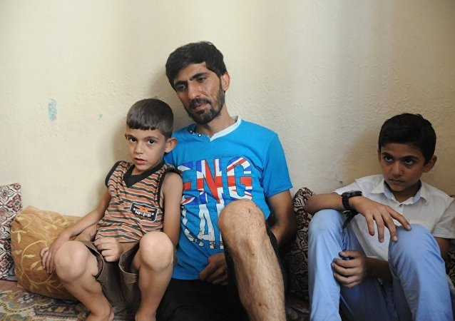 Ahmet Abdullah, whose daughter Fatma was killed in the suicide bombing attack in Gaziantep, with his two sons.
