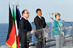 Italian Prime Minister Matteo Renzi, German Chancellor Angela Merkel (R) and French President Francois Hollande (L) lead a news conference on the Italian aircraft carrier Garibaldi off the coast of Ventotene island, central Italy, August 22, 2016.