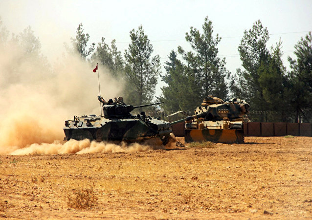 A Turkish army tank and an armoured vehicle are stationed near the Turkish-Syrian border in Karkamis in the southeastern Gaziantep province, Turkey, August 23, 2016.