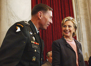 Hillary Rodham Clinton talks with Lt. Gen. David Petraeus on Capitol Hill.
