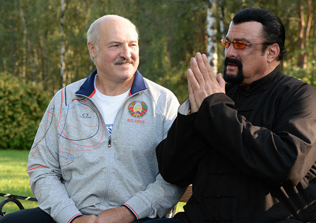 US actor Steven Seagal (R) who has been recenlty granted Serbian citizenship, gestures as he speaks with Belarus President Alexander Lukashenko (L) during their meeting at the residence of Drozdy, outside Minsk