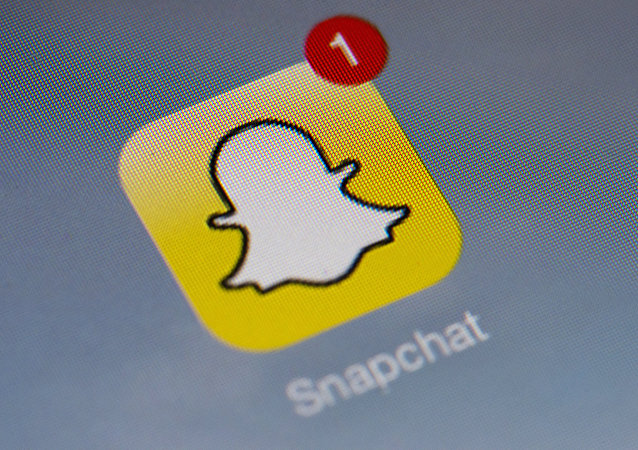 The logo of mobile app Snapchat is displayed on a tablet on January 2, 2014 in Paris.