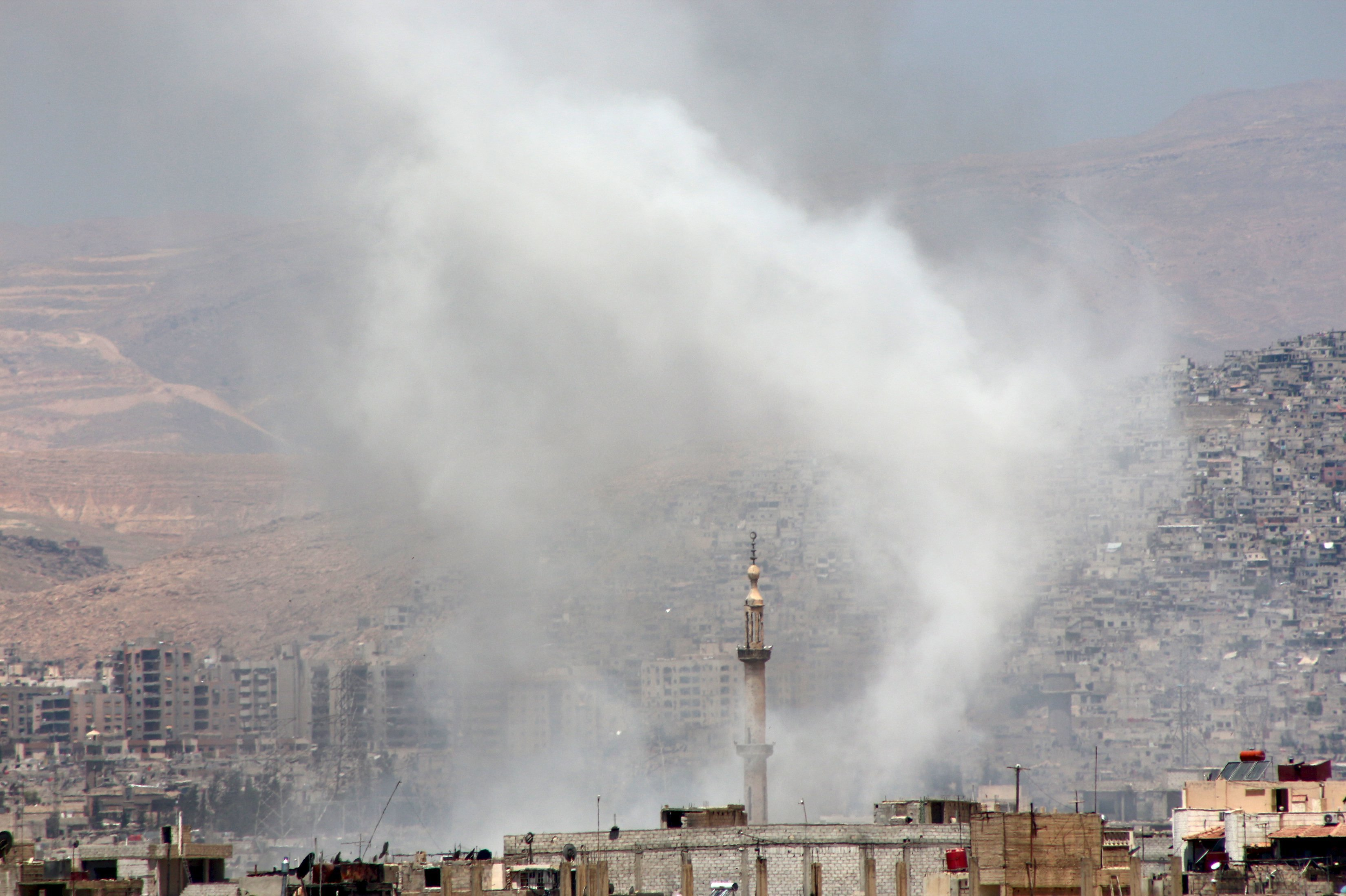 Smoke rises after what activists said was due to airstrikes by forces loyal to Syria's President Bashar al-Assad in Erbeen in the eastern Damascus suburb of Ghouta May 17, 2015.