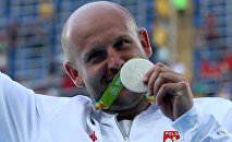 Piotr Malachowski (POL) of Poland poses with his silver medal.