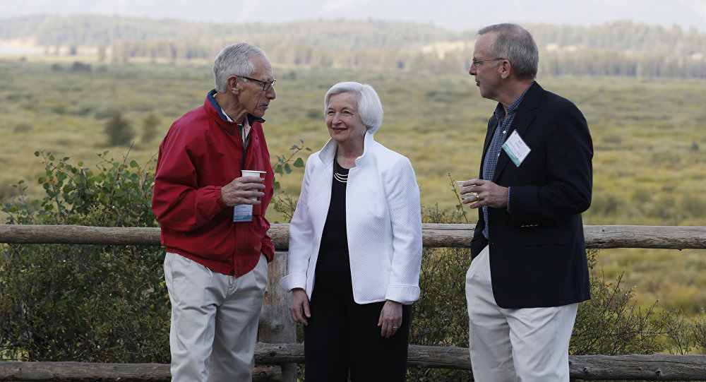 Federal Reserve Chair Janet Yellen, center, Stanley Fischer, left, vice chairman of the Board of Governors of the Federal Reserve System, and Bill Dudley, the president of the Federal Reserve Bank of New York, stroll together